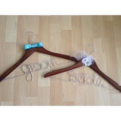 Bride & Groom hangers! Grooms hanger has a ribbon bow tie to match the wedding colors and the Brides hanger has some French netting from her veil, feathers from her hair piece and a flower from her grandmothers wedding dress. Www.gethungupshop.com Facebook.com/gethungup Gethungup@yahoo.com