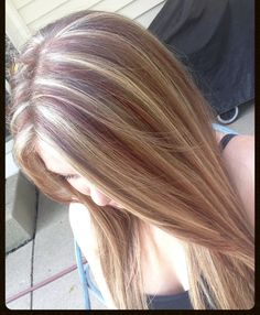 Hair color: deep red and blonde highlights on light brunette hair