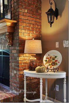 cute table by the fireplace...nice mantel, hearth and firescreen.
