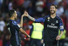 Sergio Ramos of Real Madrid CF (R) celebrates after wining the match with Lucas Vazquez of Real Madrid CF (L) during the La Liga match between Granada CF v Real Madrid CF at Estadio Nuevo Los Carmenes on May 6, 2017 in Granada, Spain.