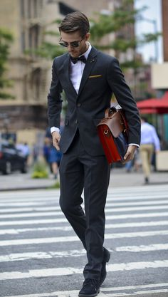 Adam from I Am Galla in a Ted Baker suit and satchel