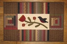 First blooms of spring-- Log cabin blocks, wool applique, and repro fabric.  Too cute!