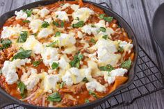 What I love about this recipe, is that its possible to have lasagna within 30 minutes and only have one pan to wash! Its an easy weeknight recipe to prepare. Comfort food with ease. :)  This is an adaption from Cooks Illustrated.