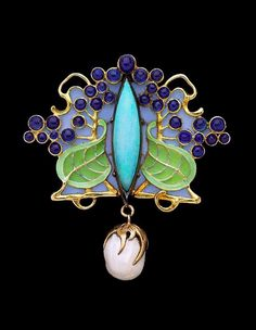 Art Nouveau pendant / brooch by René Lalique. Enamelled and set with sapphires and a pearl dangle.