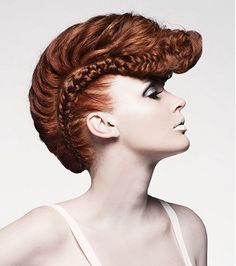 red coloured plaited updo avant garde sculptured hairstyle by Mieka Hairdressing