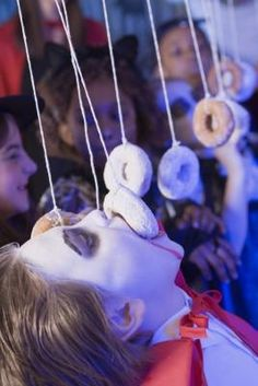 The Hottest Scary DIY Holloween Party Ideas in 2018 Fun Halloween Game Ideas.donut game is cute and choosing a word thats off limit is fun adult version could be to take a drink every time you get caught saying the word :) The Hottest Scary DI Fun Halloween Games, Soirée Halloween, Holidays Halloween, Halloween Party For Kids, Halloween Festival, Halloween Baby Showers, Adult Halloween Drinks, Holloween Games, Halloween Birthday Decorations