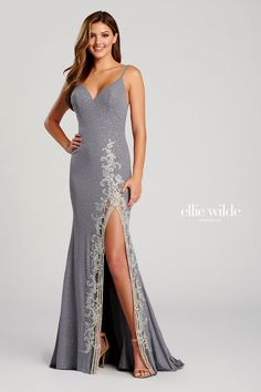 Ellie Wilde EW120044. Sleeveless shimmer jersey sheath gown with a v-neck, natural waist, strappy back, stone accents throughout gown, high thigh slit with a metallic lace applique detail and a sweep train.