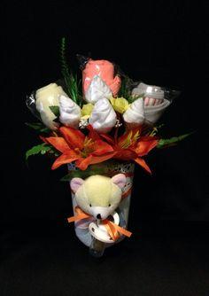 Unisex Bouquet $55 - flower pot, rattle, bib, singlet, dummy, socks, hat, mittens, booties, short bodysuit.