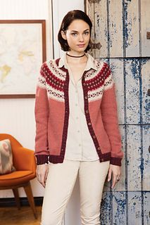 What's more traditional than a Fair Isle yoked cardigan? Knit in warm shades of HIKoo/Skacel Collection's Kenzie, which calls to mind pumpkin patches, red wine and roaring fires, this cardigan features classic construction techniques. The body and sleeves are knit separately to the armhole, then all pieces are joined to begin the yoke. Short-row shaping creates a subtle curve before the Fair Isle patterns and decreases begin.