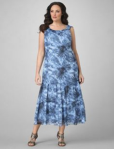 Chiffon maxi dress in a true blue tie-dye print. Pullover styling with  keyhole and looped button closure at the back of the neck. Deep,  flounced bottom. Catherines plus size dresses are expertly designed to  flatter your figure. catherines.com
