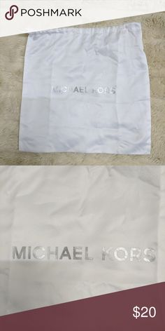 Michael Kors Dust Bag Authentic white Michael Kors square drawstring dust bag with the logo in silver. Completely clean and new. 13 x 13 inches. Michael Kors Bags