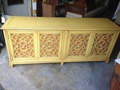 ivory and orange ornately carved sideboard