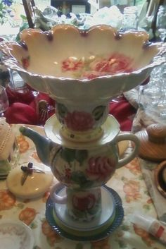 this birdbath is made from teapots and other dishes found at garage sales and thrift stores, check out Facebook page Shabby Chic Creations by Pat