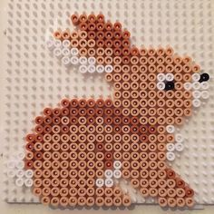 Rabbit hama beads by jifode You are in the right place about ceramic Beading Here we offer you the most beautiful pictures about the Beading dress you are looking for. When you examine the Rabbit hama Melty Bead Patterns, Pearler Bead Patterns, Perler Patterns, Beading Patterns, Quilt Patterns, Hama Beads Design, Diy Perler Beads, Perler Bead Art, Easter Crafts