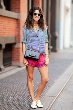 Leandra Medine in Superga shoes, Zara shirt, Pupette shorts, Ralph Lauren sunglasses, and a Valentino bag