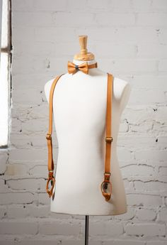 """These are genuine FULL GRAIN LEATHER suspenders HANDMADE IN US     Suspenders details:    • 1"""" wide double sided straps   • Adjustable straps  • Antique brass clips  • Neatly packaged in a cotton bag with tags (Perfect as a gift!)  • Matching leather bow tie available (Receive 15% OFF bow tie and suspenders when buying together!)  • Handcrafted in New Orleans    Size:    Measure the distance from center-back waistline (diagonally over the shoulder) to the front waistline. When considering…"""