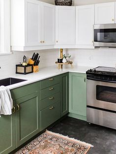 kitchen cabinet paint ideas: green lower and white upper cabinets