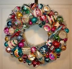 Antique ornaments wired to a wreath.