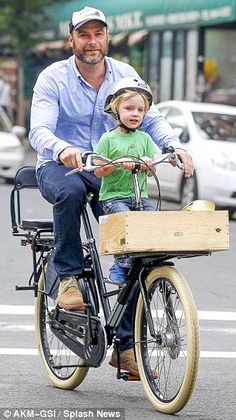 Liev Schreiber goes for a cycle with his son