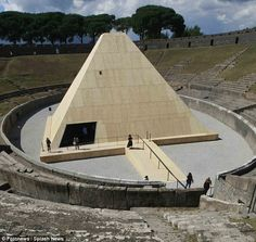 The 12-metre high pyramid allows visitors to walk along a track before entering it. It is built almost entirely out of wood with an inner dome made of fiberboard  Inside, they will be find the casts of Roman citizens killed more than 1,900 years ago in 79AD when Mount Vesuvius erupted with devastating force destroying the Roman towns of Pompeii and Herculaneum.