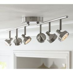Shine light in the direction you require with the adjustable light heads of this brushed steel LED ceiling light. Track Lighting Kits, Track Lighting Fixtures, Ceiling Light Fixtures, Led Ceiling Lights, Kitchen Lighting, Farmhouse Track Lighting, Lighting Ideas, Lighting Design, Contemporary Track Lighting