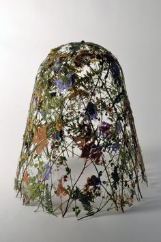 Designer Ignacio Canales Aracil created these amazing sculptures by pressing and drying wild flowers collected from gardens and nurseries in the UK. The flowers are held together without any structure or glue, they stand and stick together as the straw in a hat after being dried and pressed all at once. The roughness of the process which requires lots of physical effort contrast with the delicacy and fragility of the finished sculpture.