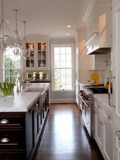 Two tone kitchen with white cabinets and espresso dark island w/ Carrara Marble | Pop.Clink.Fizz.