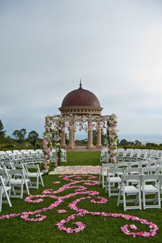 I love the flower peddles and how the chairs go all the way around the bride and groom so everyone can see.