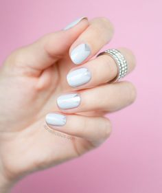 Silver and Grey Triangles | Complete your wedding day look by adding a pop of color or a subtle design to your nails. Most of these designs are so simple, you don't even need to hire a professional.