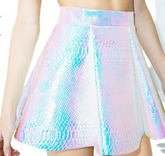 Look like the QUEEN of the unicorn mermaids in this holographic skirt! This fabric features mermaid scale print and changes colors in different lighting.