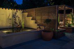 A stunning raised water pool, featuring a bespoke copper fish sculpture by Dorset artist, Brendon Murless. Fish Sculpture, Surrey, Bespoke, Copper, Gardens, Landscape, Water, Artist, Design