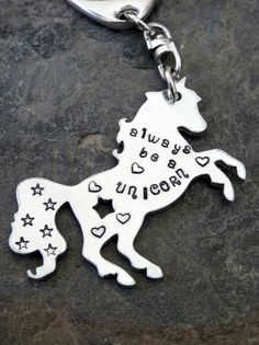 A must for Unicorn lovers!!  My beautiful shiny little unicorn measures 2 long plus keychain and comes stamped as shown. If you would like an alternative quote please send me a message before purchasing to check it will fit. This listing is for a Unicorn keyring - please see separate listing for Unicorn pendant.    * * * * * I take great care to ensure that each and every piece of jewellery or gift leaves my workshop looking fabulous. My work is handstamped, which means that each letter or…