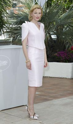 Cate Blanchett in blush skirt suit w/ uniquely cut neckline & sleeves, mauve lips & blonde lob swept back