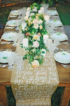 table runner with calligraphy - photo by ArinaB Photography http://ruffledblog.com/soft-and-modern-wedding-inspiration