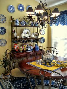 THIS is how I picture MY dining room, only with turquoise and red and yellow and black, NOT blue/white