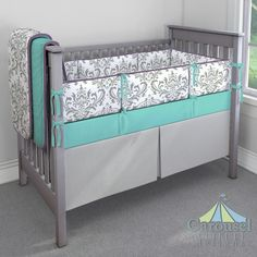 Crib bedding in Solid Teal, Gray Traditions Damask, Solid Aubergine Purple, Silver Gray Minky. Created using the Nursery Designer® by Carousel Designs where you mix and match from hundreds of fabrics to create your own unique baby bedding. #carouseldesigns