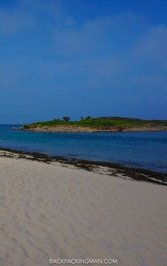 White sand beach at Pelistry Bay on the Isles of Scilly during summer.