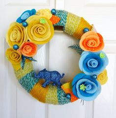 Yarn Wreath - Glittered Elephant Collaboration via Etsy. This is one of the collaborative pieces from the Knock-Knocking and Wish Daisy.