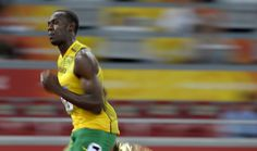 Jamaica's Usain Bolt competes in a men's 100-meter second round heat during the…