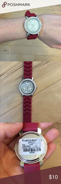 Red Francesca's watch with diamond embellishment Ruby red watch with diamond embellishment around the face. The red on it is made of rubber, so it is very comfortable and non-constricting. Francesca's Collections Accessories Watches