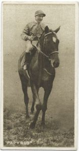PAPYRUS Papyrus, the Epsom Derby champion, met America's Kentucky Derby winner, Zev, at Belmont in a Match Race on October 20, 1923. Papyrus is shown here with famous jockey, Steve Donaghue, up. Of note, the British Derby champion figures in Zenyatta's pedigree.