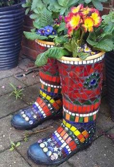 Tiled boots. Great idea for kid's outgrown boots! Fill with concrete.