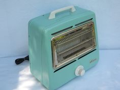 Retro aqua turquoise Arvin electric space heater, early 1950s vintage