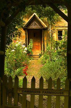 Looking through the Arbor  ~  Farmhouse and English Garden in Upper Slaughter, Gloucesteshire, England.
