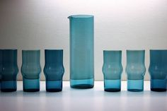 Kaj Francks everyday glassware is characterized by a strong sense of geometric form. Pitcher 1609 was designed in 1954. Tumblers 1711 were designed on 1958. Both were manufactured until mid 1960s in Finland, Nuutajärvi glass factory.  As Kaj Franck's design aimed at practicality