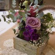 Rustic wooden box centrepiece of mauve roses, babies breath, gum, proteas, penny sedum  www.jademcintoshflowers.com.au www.margan.com.au