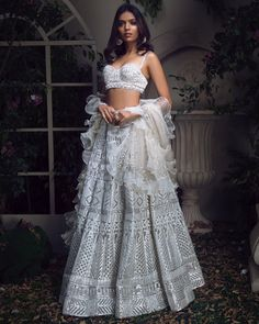 Inquiry To Ask For More Information Contact Us On WhatsApp : 9820077537 Pearled ivory chrome applique lehenga With embroidered blouse & ruffled dupatta Material: Organza and Tulle Lining-Pure Crepe Model is Indian Lehenga, Indian Gowns, Indian Attire, Indian Ethnic Wear, Lehenga Choli, Sabyasachi, Indian Wedding Wear, Indian Bridal Outfits, Indian Designer Outfits