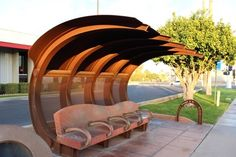 """Artist Kevin S. Berry brings an architectural approach to the common bus shelter. Located at the corner of Camelback and his weathered-steel """"Wavelength"""" was constructed in 2005 Green Architecture, Architecture Design, Empire State, Bus Stop Design, Bus Shelters, Shelter Design, Shade Structure, Grill Design, Outdoor Chairs"""