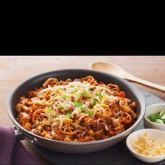 U need to try this dish.. 10x better then hamburger helper!   Taco pasta  1 lb. extra-lean ground beef 1 yellow onion, chopped 1 cup each chopped red and yellow peppers 1 clove garlic, minced 1 Tbsp. chili powder 3 cups water 1 can (15 oz.) tomato sauce 3 cups wagon wheel pasta, uncooked 1/2 cup frozen corn 1 cup KRAFT Mexican Style Shredded Four Cheese with a TOUCH OF PHILADELPHIA 1 green onion, diagonally cut into thin slices Salt and pepper Onion powder  Make It Brown meat with yellow…