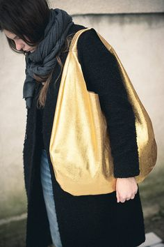 A gold bag adds some gleam to a fall look.